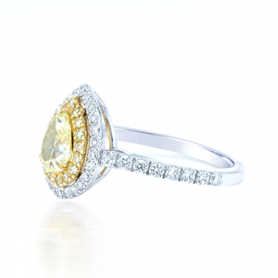 1.31Cts pear shape fancy yellow halo engagement ring
